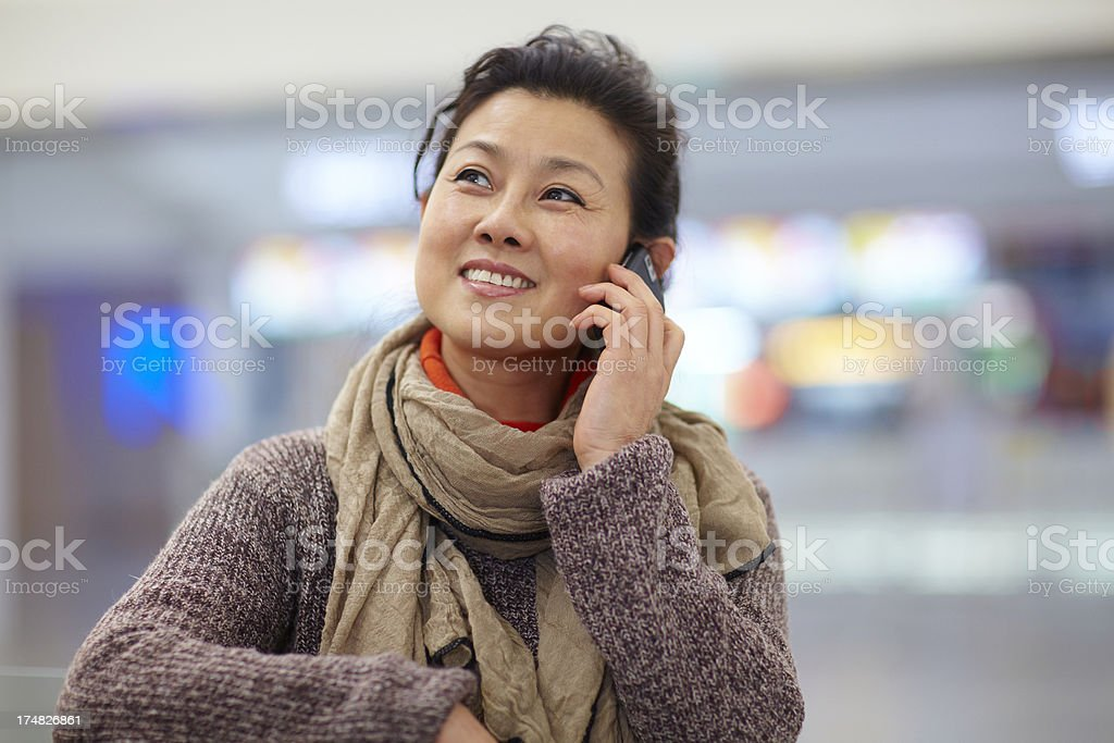 happy mature woman talking on the phone royalty-free stock photo