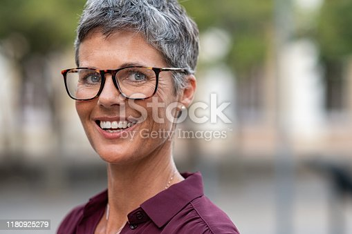949435100 istock photo Happy mature woman with spectacles 1180925279