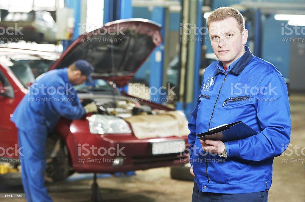 happy mechanic technician at service station royalty-free stock photo