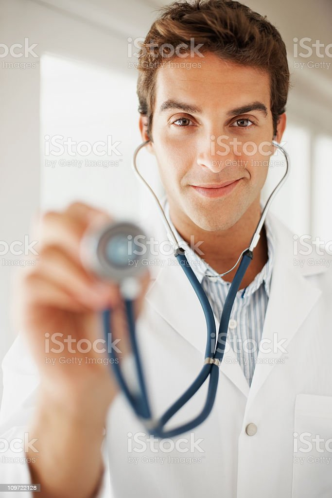 Happy medical doctor holding stethoscope royalty-free stock photo