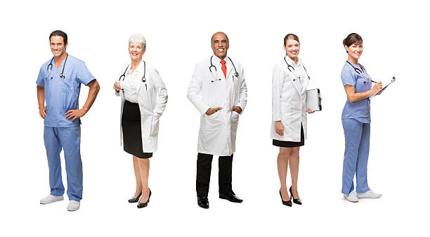 Happy medical professionals Portrait of happy medical professional isolated over white akimbo stock pictures, royalty-free photos & images