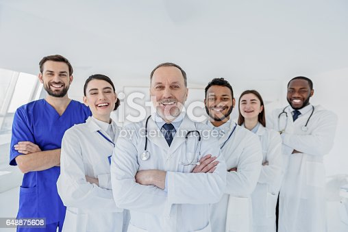istock Happy medical team is ready to work 648875608