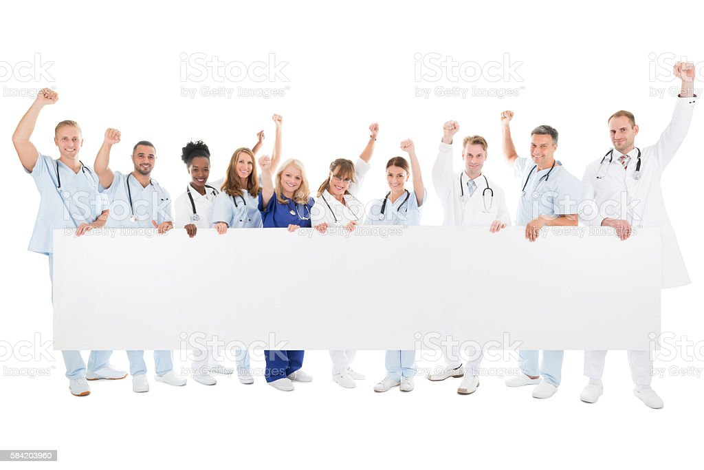 Happy Medical Team With Arms Raised Holding Blank Billboard - foto de acervo