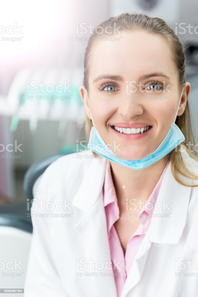Happy medicine expert with surgical mask royalty-free stock photo