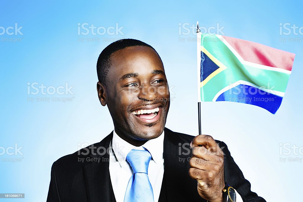 Happy member of the Rainbow Nation waves South African flag