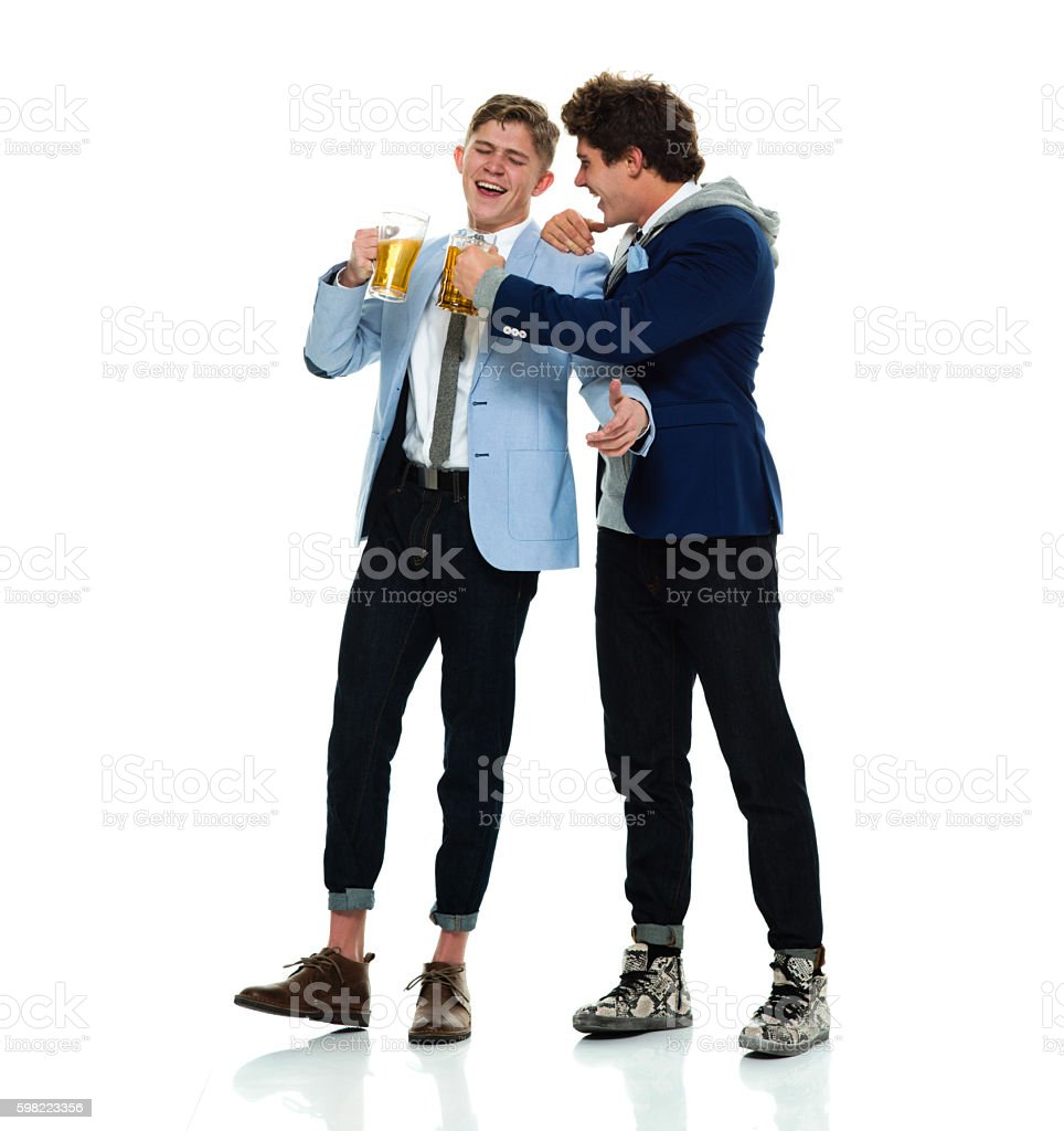 Happy men holding drinking glass - foto de stock