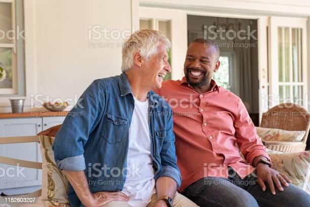 Happy Men In A Conversation - zdjęcia stockowe i więcej obrazów 30-39 lat