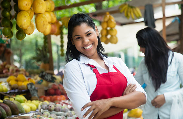 Happy mexican saleswoman on a farmers market stock photo