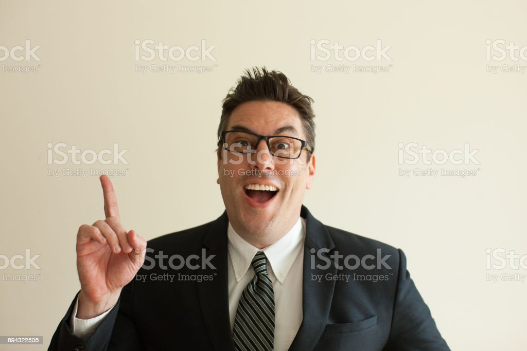 Happy mid adult businessman in glasses having idea stock photo