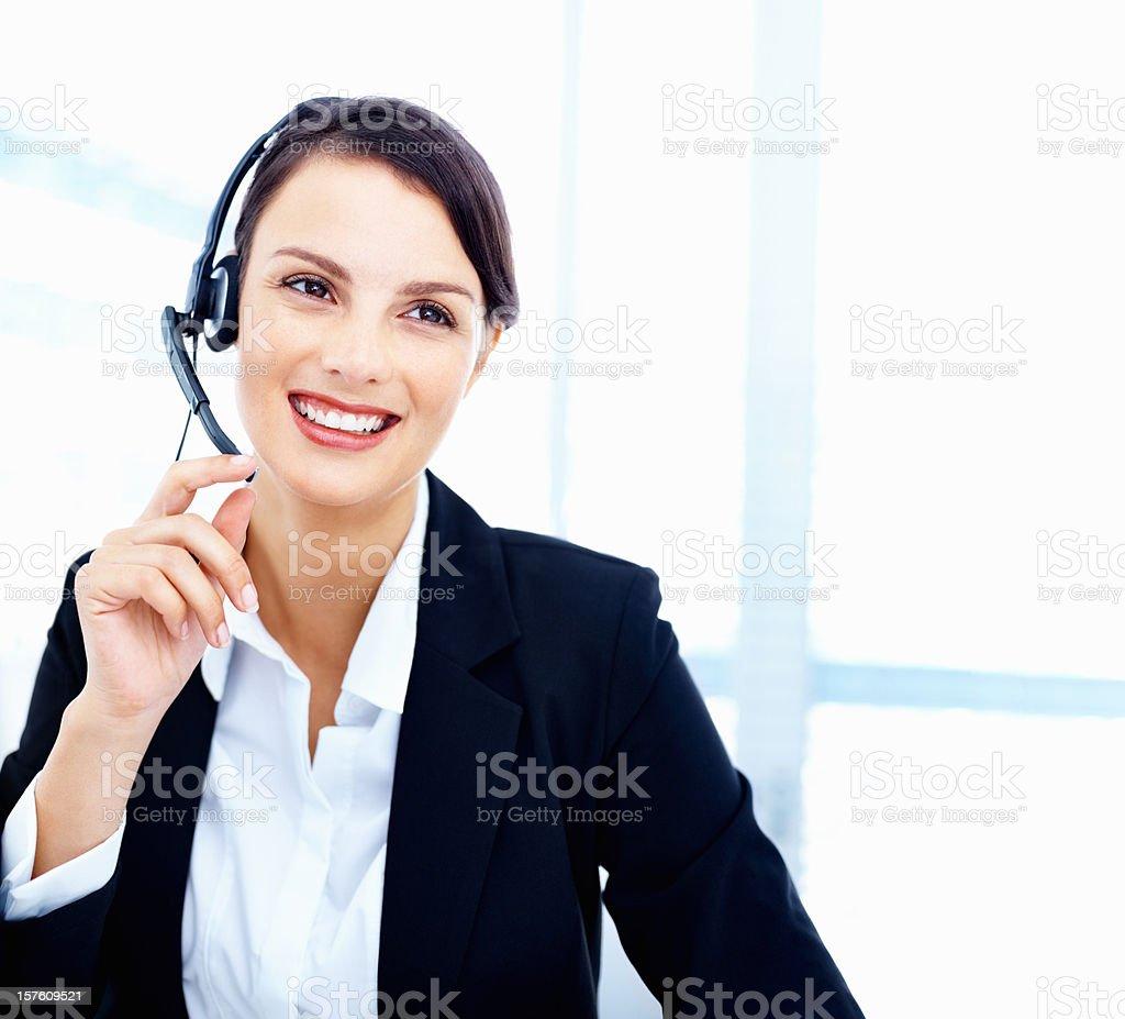 Happy mid adult customer representative wearing headset royalty-free stock photo