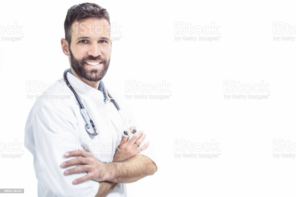 Happy mid adult male doctor looking at camera on white background. stock photo