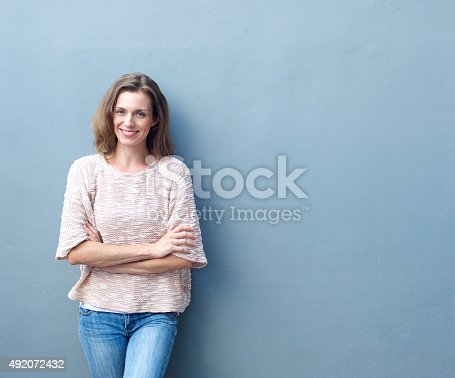 istock Happy mid adult woman smiling with arms crossed 492072432
