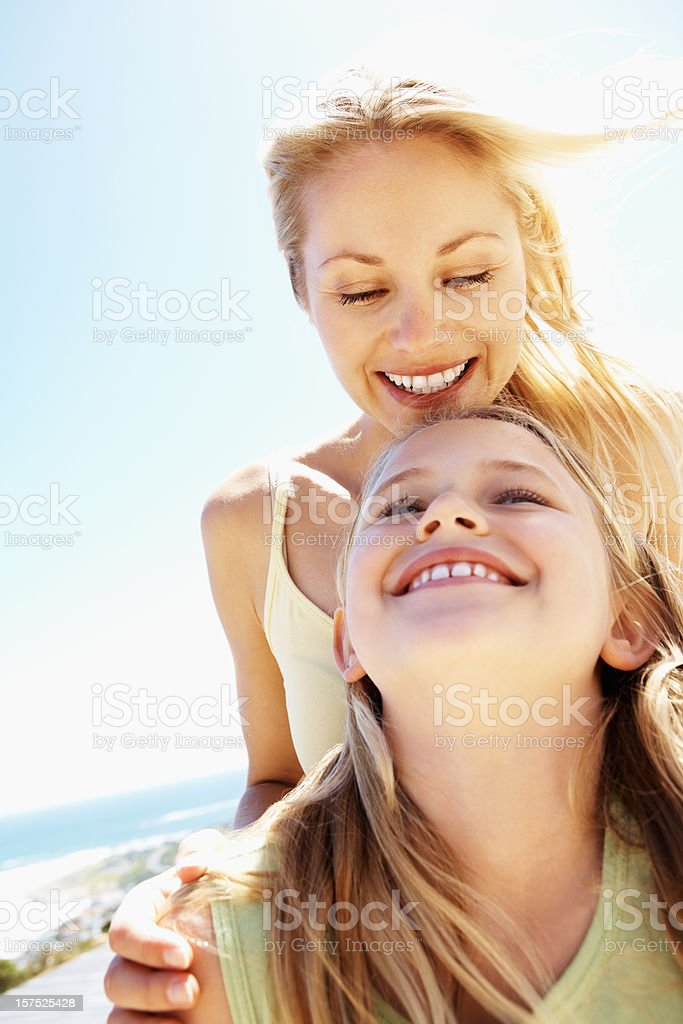 Happy mid adult woman with her daughter royalty-free stock photo