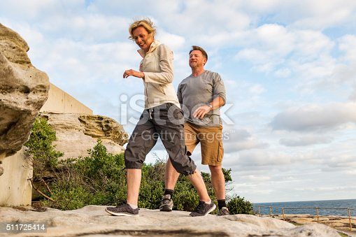 istock Happy Middle Aged Active Fit Healthy Beach Couple Hiking Outdoors 511725414