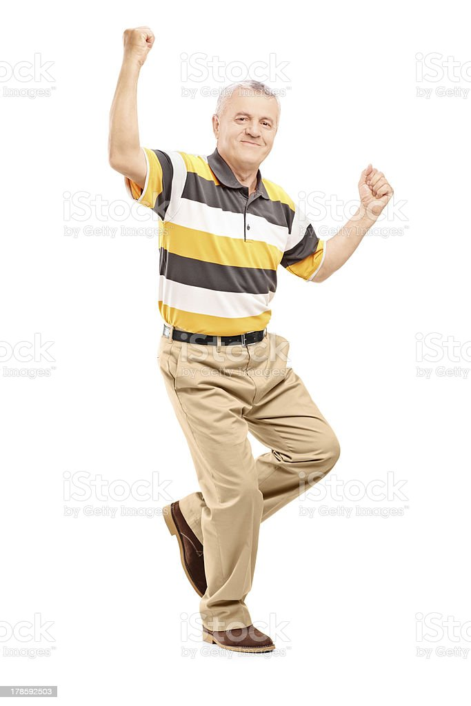Happy middle aged gentleman gesturing happiness royalty-free stock photo