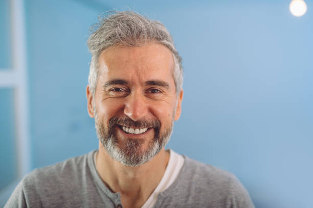 happy middle aged gray haired bearded man happy middle aged gray haired bearded man smiling 40 44 years stock pictures, royalty-free photos & images