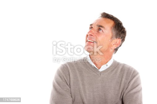 istock Happy middle aged guy looking at copyspace and smiling 174769606