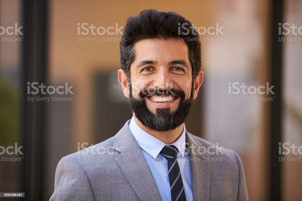 Happy middle aged Hispanic businessman looking to camera stock photo