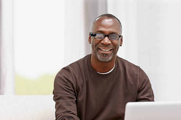 Happy middle aged male using latest technology stock photo