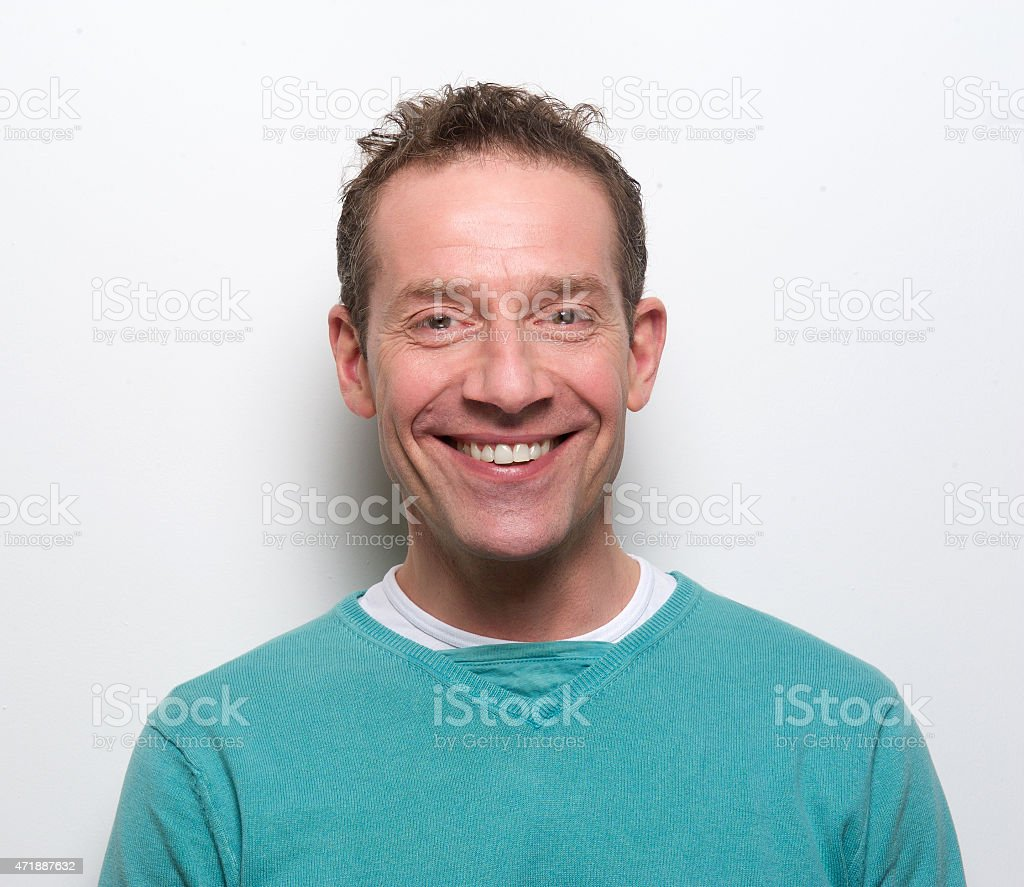Happy middle aged man smiling stock photo