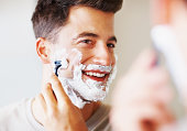 istock Happy middle aged man using razor to shave 109720549