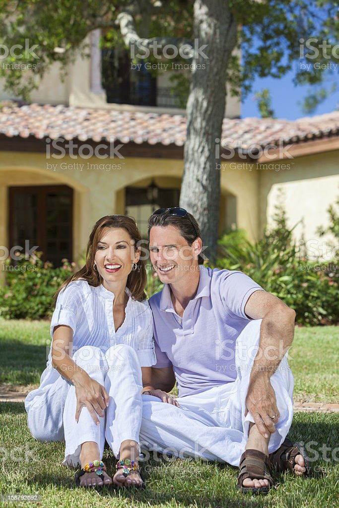 Happy Middle Aged Man Woman Couple Sitting Outside royalty-free stock photo