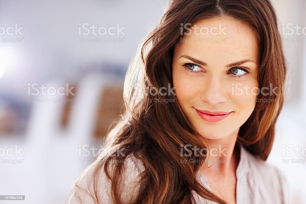 Happy middle aged woman looking away stock photo