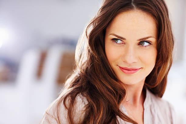 happy middle aged woman looking away - mid volwassen vrouw stockfoto's en -beelden