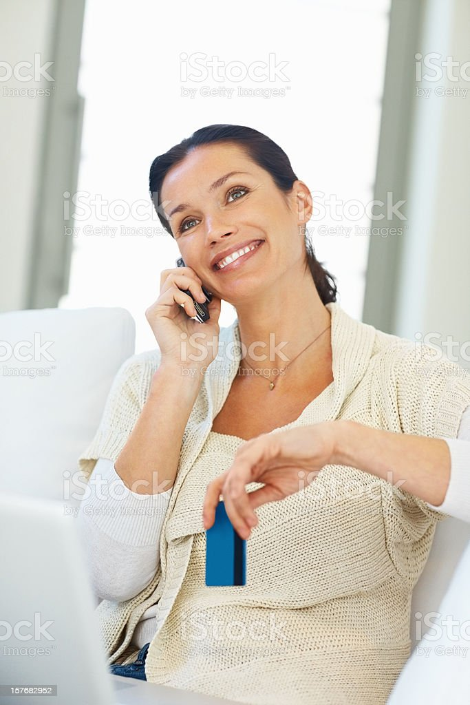 Happy middle aged woman over the cellphone at home royalty-free stock photo