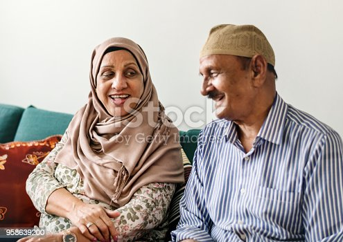 istock Happy Middle Eastern mature couple at home 958639200