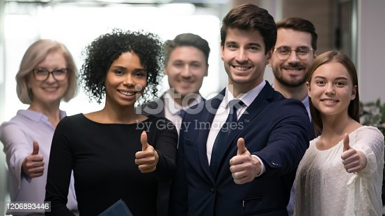 istock Happy millennial colleagues evaluating career opportunity in company. 1206893446