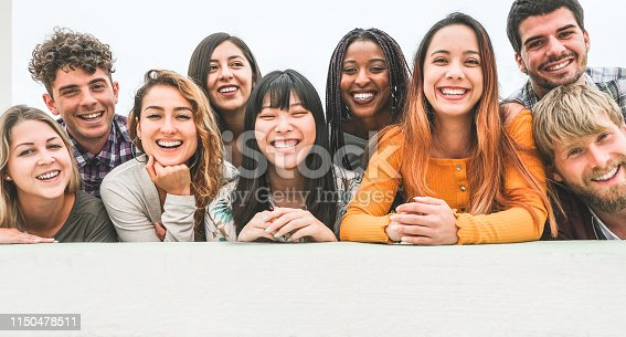 861023492istockphoto Happy millennial friends from diverse cultures and races having fun posing in front of smartphone camera - Youth and friendship concept - Young multiracial people smiling - Main focus on center faces 1150478511