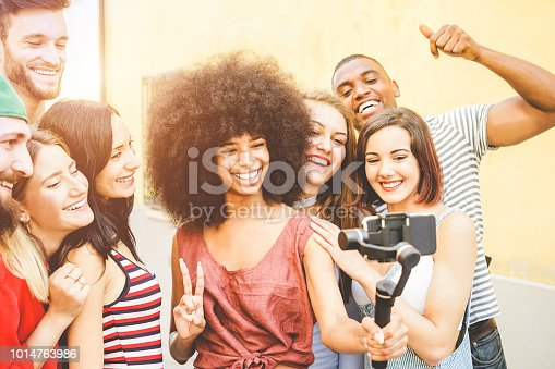 Happy millennials friends making video feed with smartphone outdoor - Young generation z people having fun with new technology trends - Youth lifestyle and social media concept - Focus on right girls