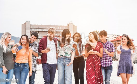 istock Happy millennials friends walking together outside of university - Young students having fun laughing and chatting - Youth, lifestyle, friendship and mutiracial concept - Focus on faces 1155415218