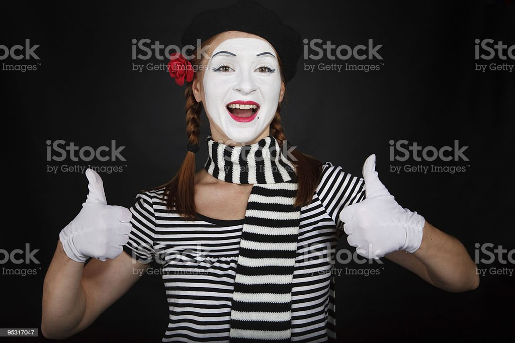 Happy mime comedian showing thumbs up royalty-free stock photo