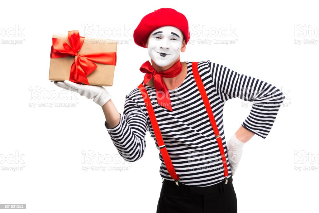 happy mime holding present box isolated on white stock photo