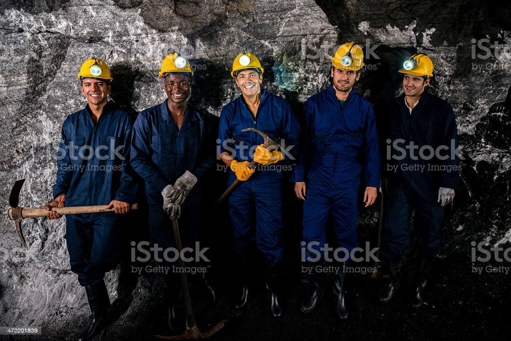 Happy miners smiling royalty-free stock photo
