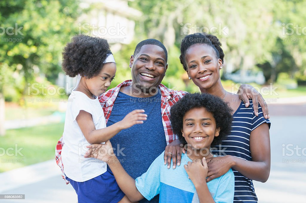 Happy mixed race African American family, mischief stock photo