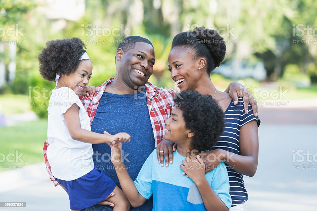 Happy mixed race African American family of four stock photo