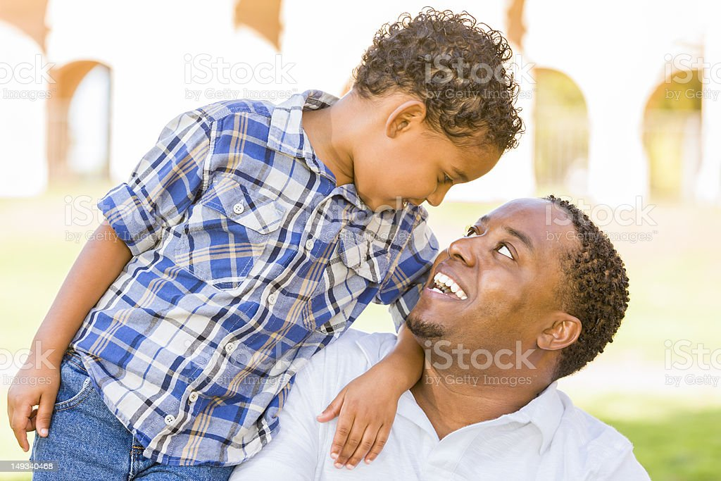 Happy Mixed Race Father and Son Playing stock photo