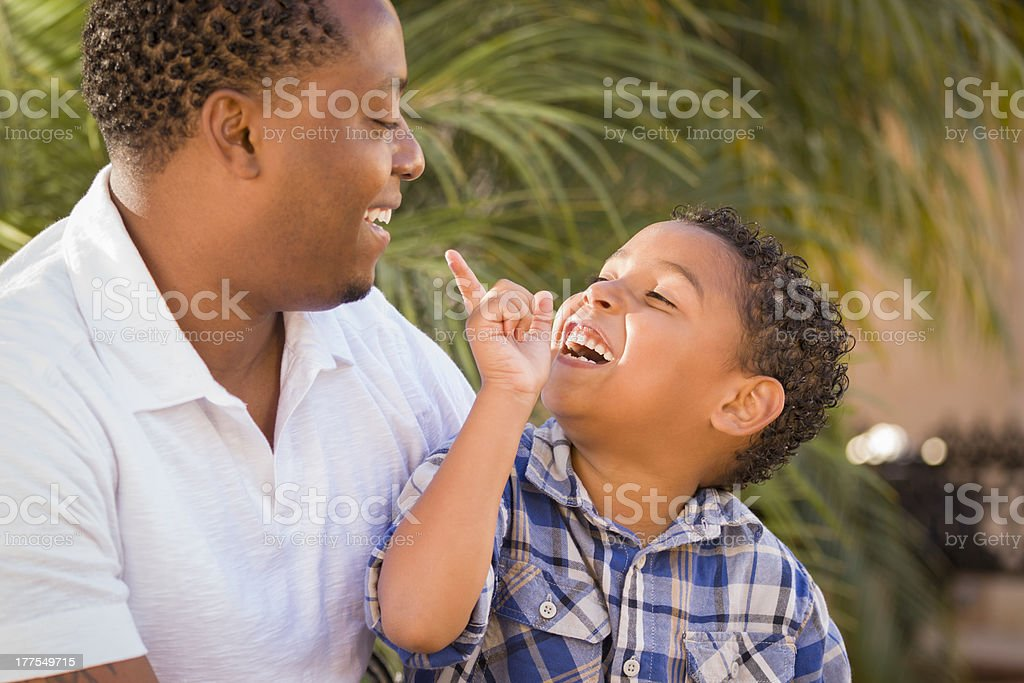 Happy Mixed Race Father and Son Playing royalty-free stock photo