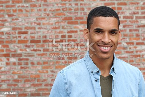 istock Happy Mixed Race Male Smiling Portrait 843214016