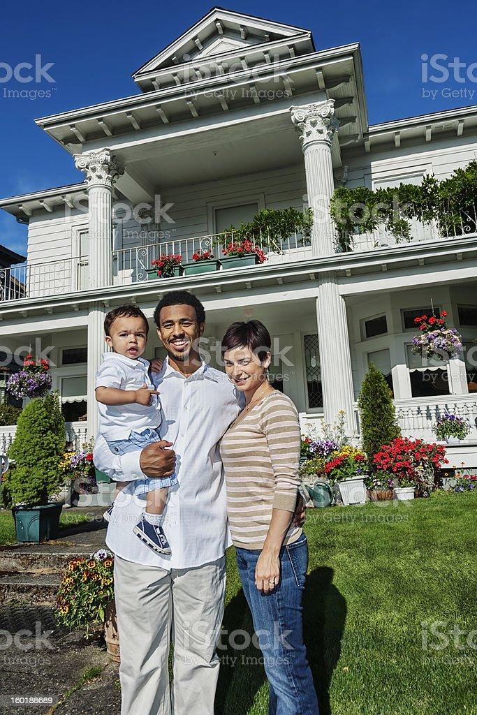 Happy Mixed-race Family of Three at Home royalty-free stock photo
