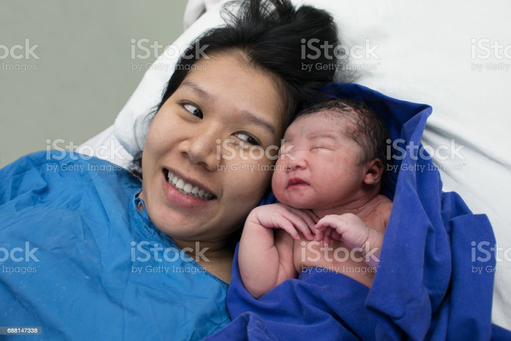 happy mom and childbirth baby asian girl stock photo