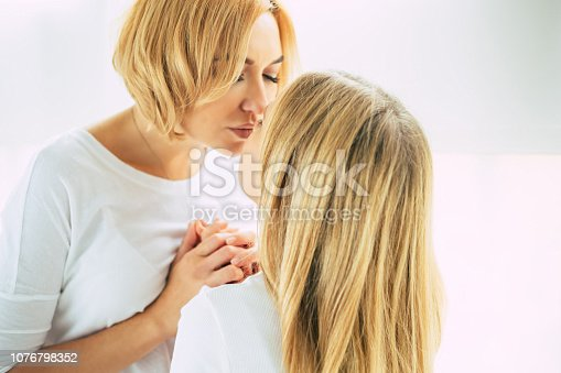 641288086istockphoto Happy mom and daughter at home 1076798352