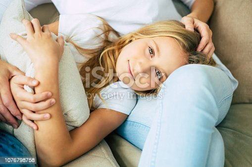 641288086istockphoto Happy mom and daughter at home 1076798758