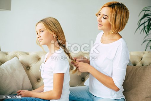 641288086istockphoto Happy mom and daughter at home 1076798768