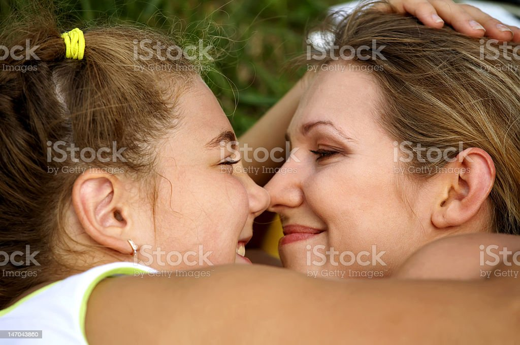 Happy mom and daughter smiling royalty-free stock photo