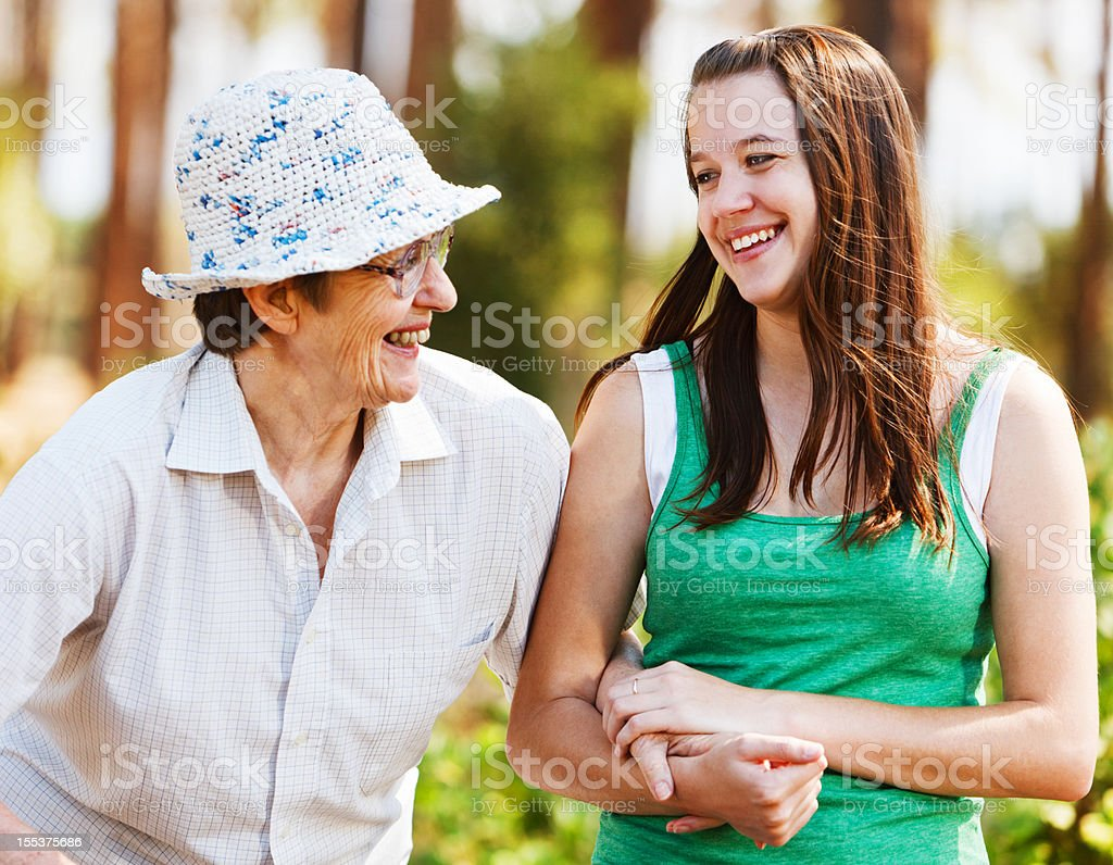 Happy moment of bonding between old woman and young girl royalty-free stock photo