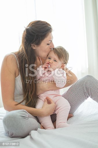 538360916 istock photo Happy momy huging her daughter on morning bed 510173812